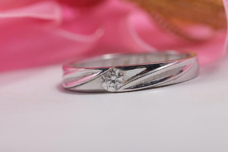 White gold engagement ring with diamond stock photo