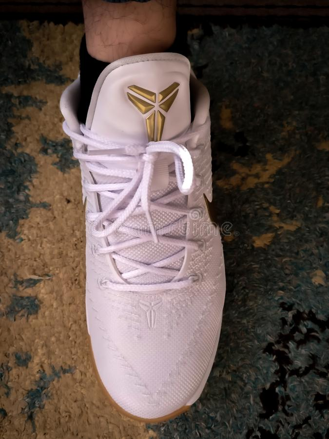 White and gold Kobe Bryant nike sneaker Black Mamba royalty free stock photo