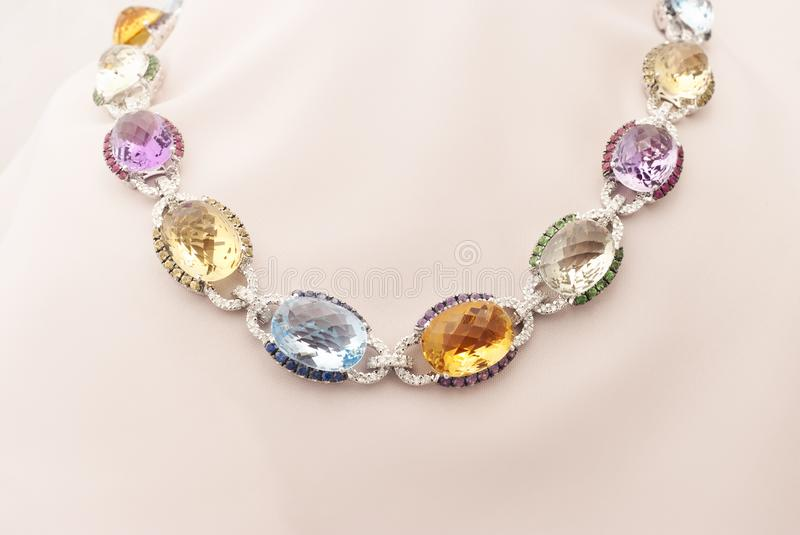 White Gold Necklace With Blue And Yellow Sapphire, Rubies, Amethyst, Green Garnet And Diamonds stock images