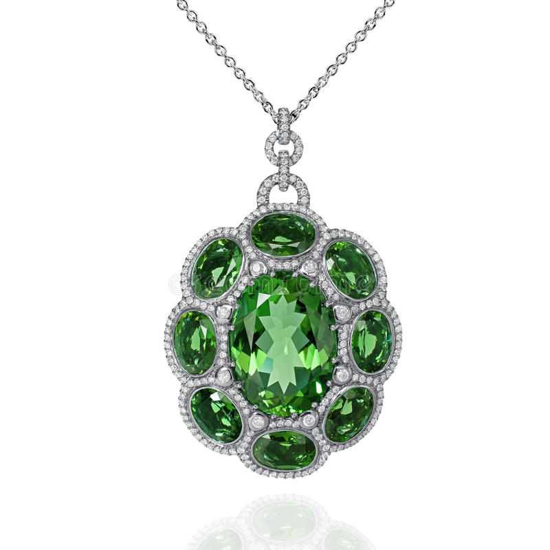 White gold pendant with green emerald and white diamonds stock photography