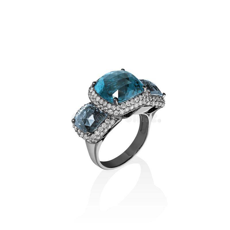White gold ring with blue topaz and multiple diamonds, cushion cut gems stock photos