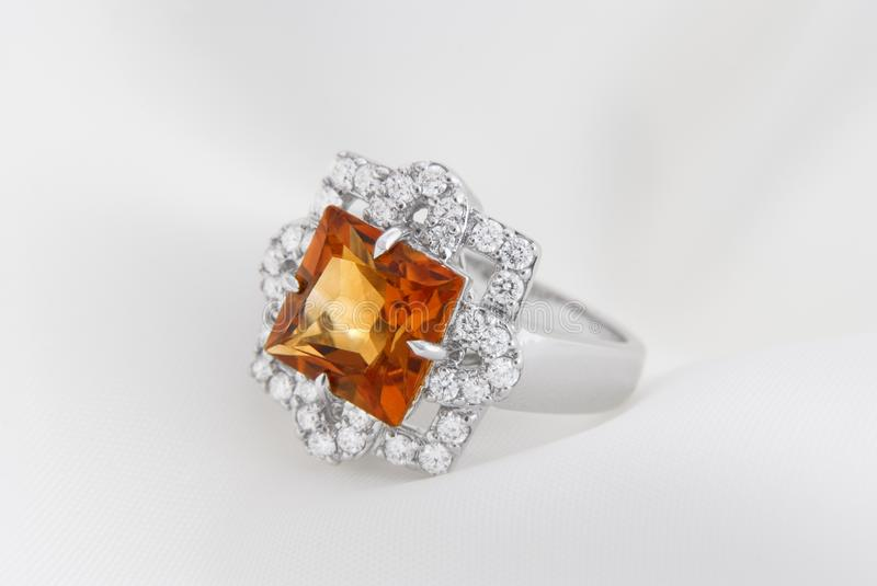 White Gold Ring With Citrine And Diamonds On Soft Whit. E Background royalty free stock photos