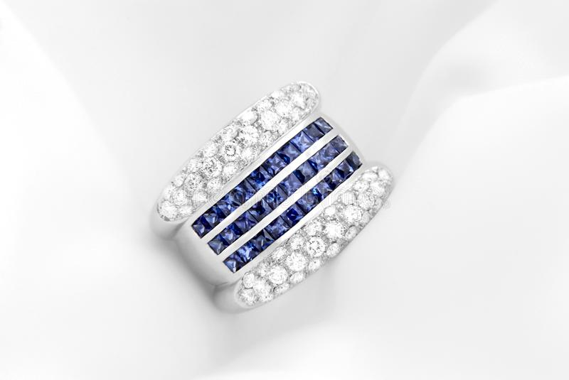 White Gold Ring With Diamonds And Deep Blue Sapphires royalty free stock photo