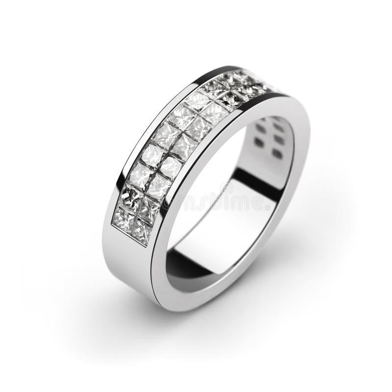 White gold wedding ring with white diamonds, cut p royalty free stock photos