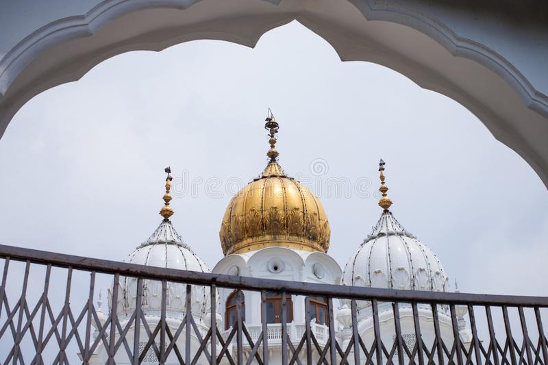 White and golden domes of mosques stock image