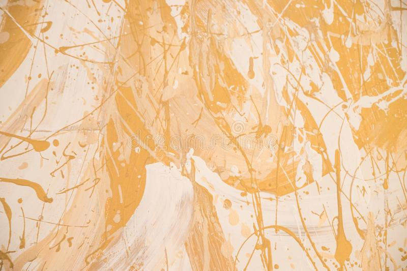 White and golden messy wall stucco texture background. Decorative wall paint.Shiny yellow leaf gold foil texture stock photography