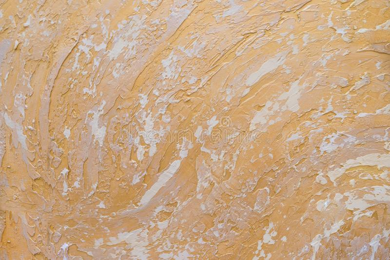 White and golden messy wall stucco texture background. Decorative wall paint.Abstract gold color painted on grunge rough royalty free stock images