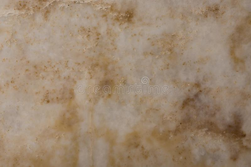 White and golden quartz stone texture, translucent agate stone. Structure close up background royalty free stock images