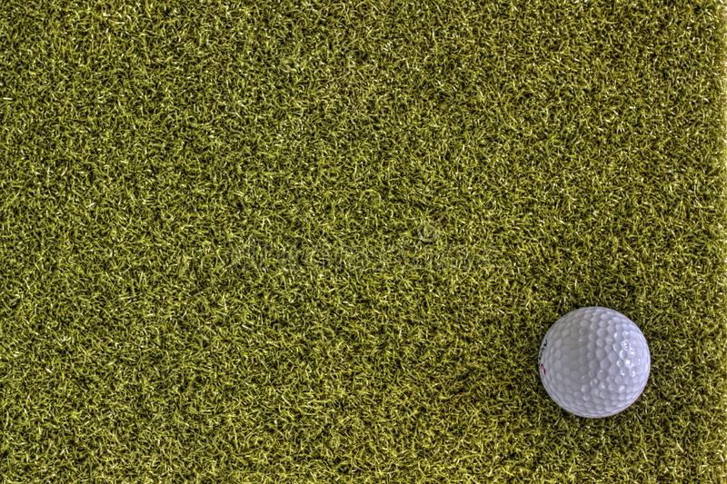 Golf ball on green back ground. White golf ball on green back ground negative space stock images