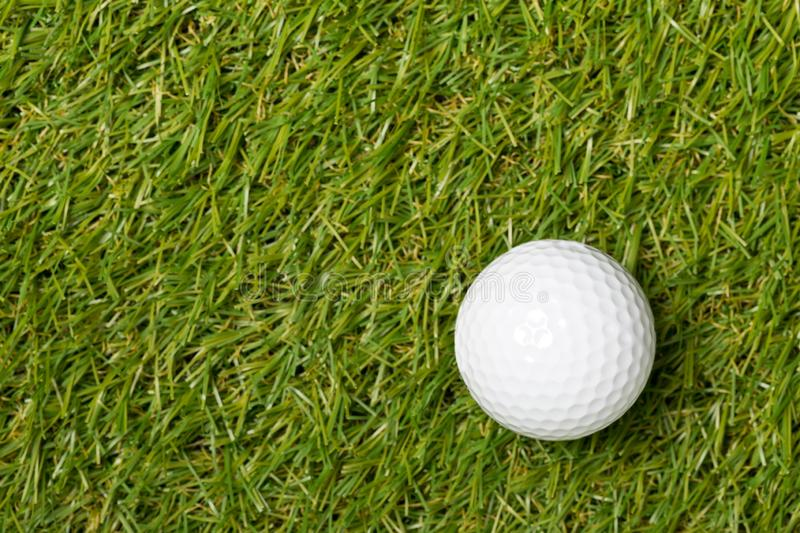 White golf ball on green grass lawn with copy space top view flat lay from above with copy space stock photos