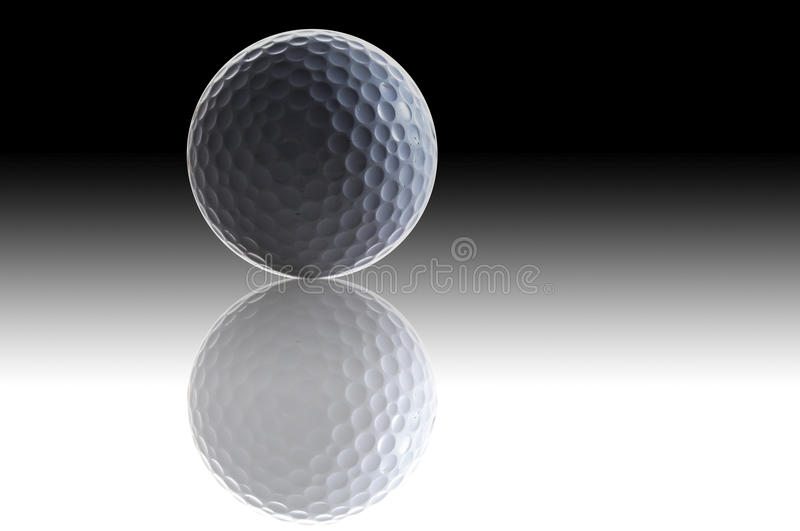 White golf ball and shadow stock image