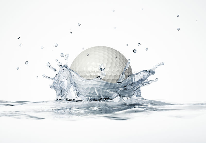White golf ball splashing into water, forming a crown splash. stock photography
