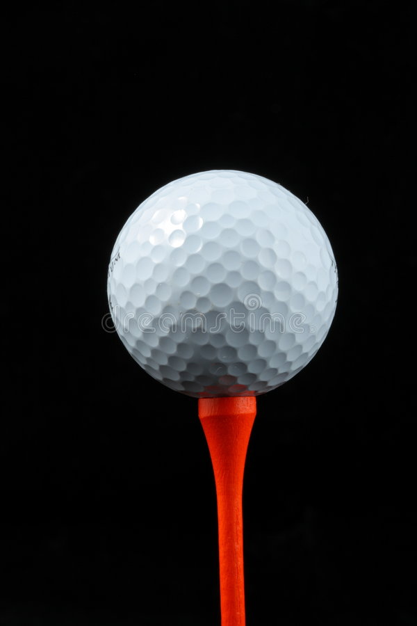 White golf ball on a tee stock image