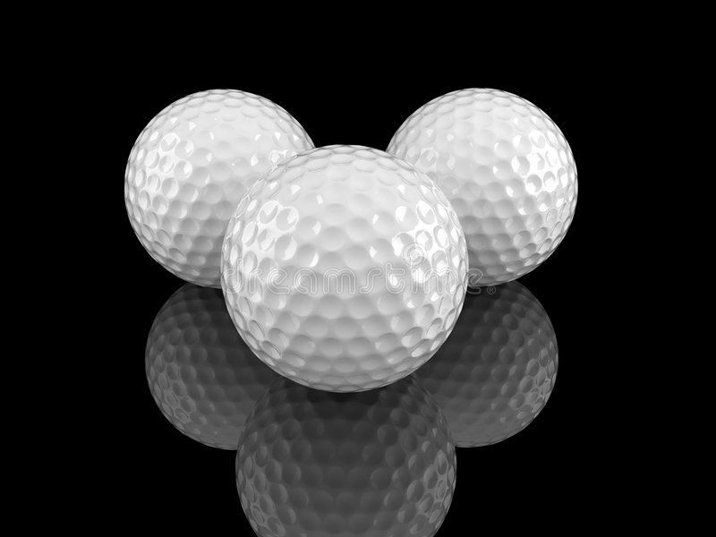 White golf balls with ground reflection stock image
