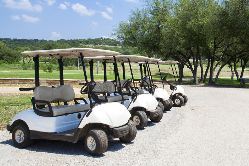 White golf carts lined up stock images