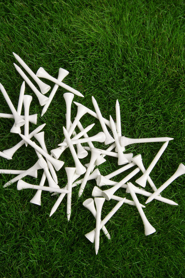 White golf tees stock photography