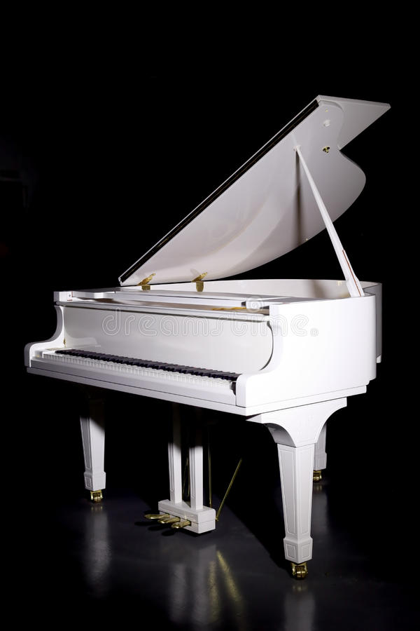 White grand piano. The image of a white grand piano royalty free stock photo