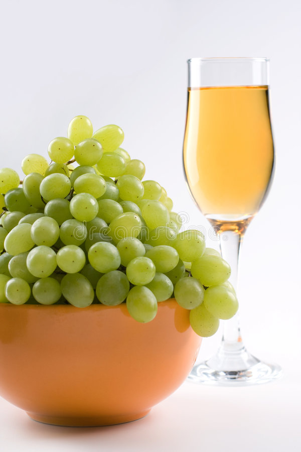 White grapes with juice. Bunch of grapes with glass of juice royalty free stock photo