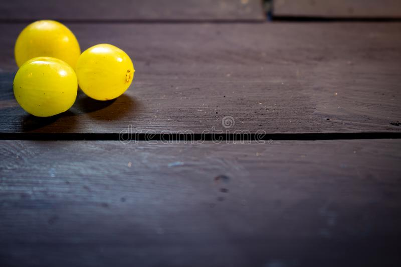 White grapes on a rustic wooden board. Healthy breakfast concept stock photography