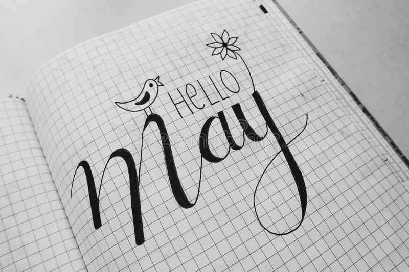 White Graphing Paper With Hello May Text royalty free stock photo