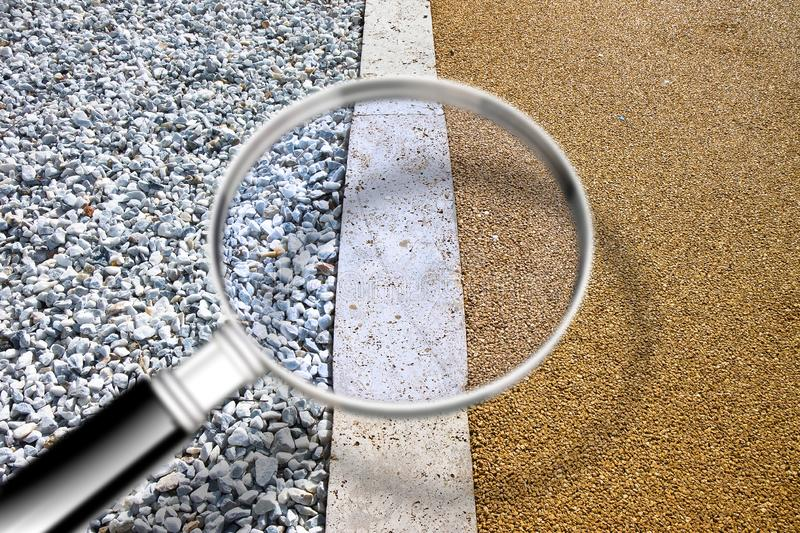 White gravel and stone pavement - image with copy space - Concept image seen through a magnifying glass royalty free stock photography