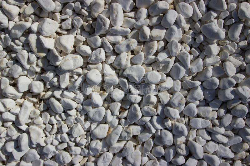 White Gravel Stones, Pattern, Texture,. Background, Wallpaper. Litlle Stones on the Ground royalty free stock photography
