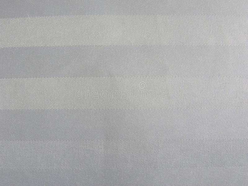 White and gray color cotton fabric background. White and gray color stripes cotton fabric textured background royalty free stock photography