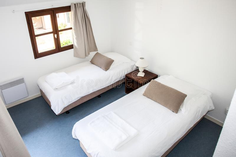 Two single beds in a cosy cottage royalty free stock photo