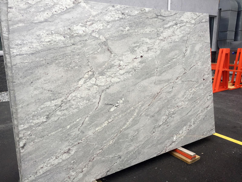 White and gray Granite slab. Full slab of polished river white granite veined with white and gray for modern counter top royalty free stock images