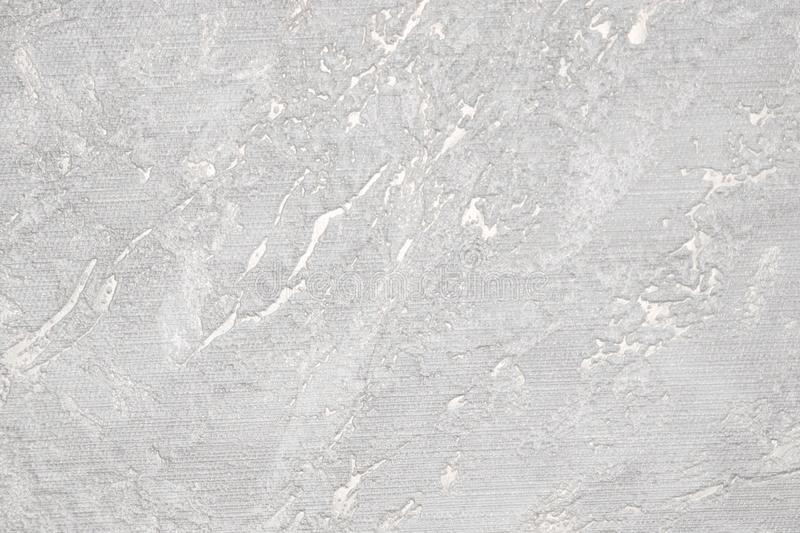 White and gray grooved texture. White rough surface. Gray uneven background royalty free stock photography