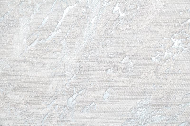 White and gray grooved texture. White rough surface. Gray uneven background stock image