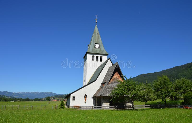 White and Gray Painted Chapel Near Green Open Field during Daytime stock images