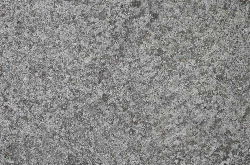 White gray texture of the artificial stone. Made of marble pieces and cement royalty free stock photos