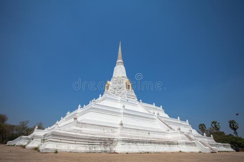 The white great chedi Phu Khao Thong in blue sky. Was built to celebrate the victory of King Naresuan over the Burmese royalty free stock photography