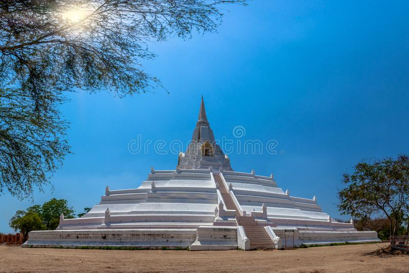 The white great chedi Phu Khao Thong in blue sky. Was built to celebrate the victory of King Naresuan over the Burmese royalty free stock photo