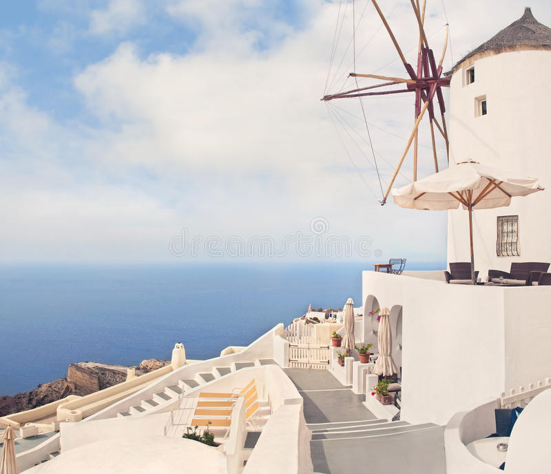 White greek windmill and cafe on sunny day stock photo