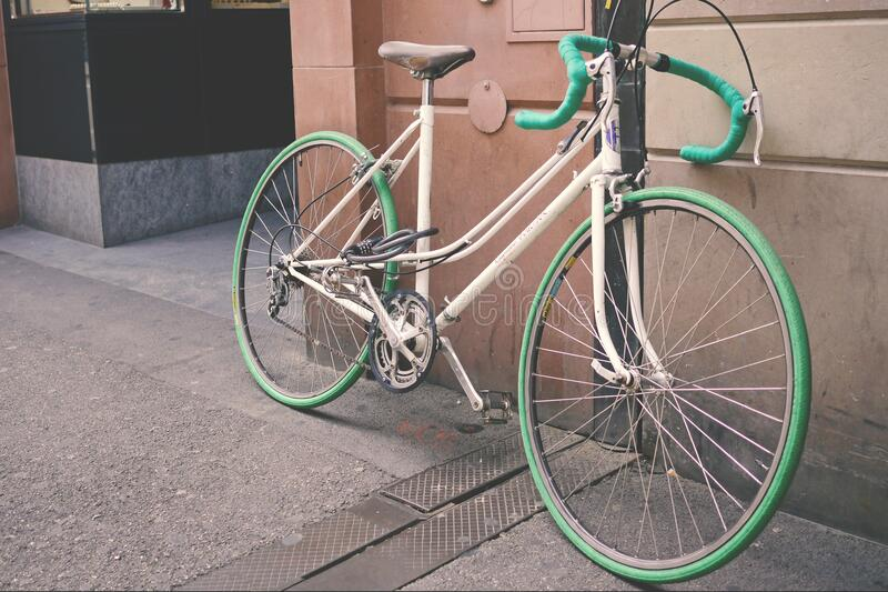 White And Green Bike Leaning On Wall Free Public Domain Cc0 Image