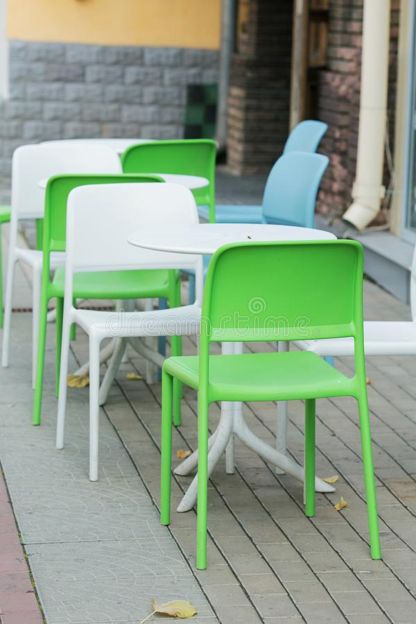 Wooden chairs close-up in a cafe. Wooden chairs close-up in a street cafe royalty free stock photography