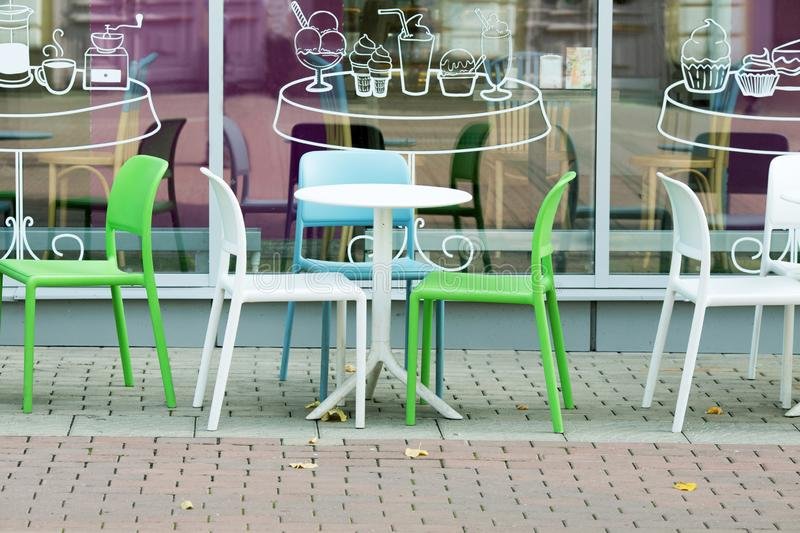 White and green plastic tables and chairs of a cafe. White and green plastic tables and chairs of a street cafe stock photos