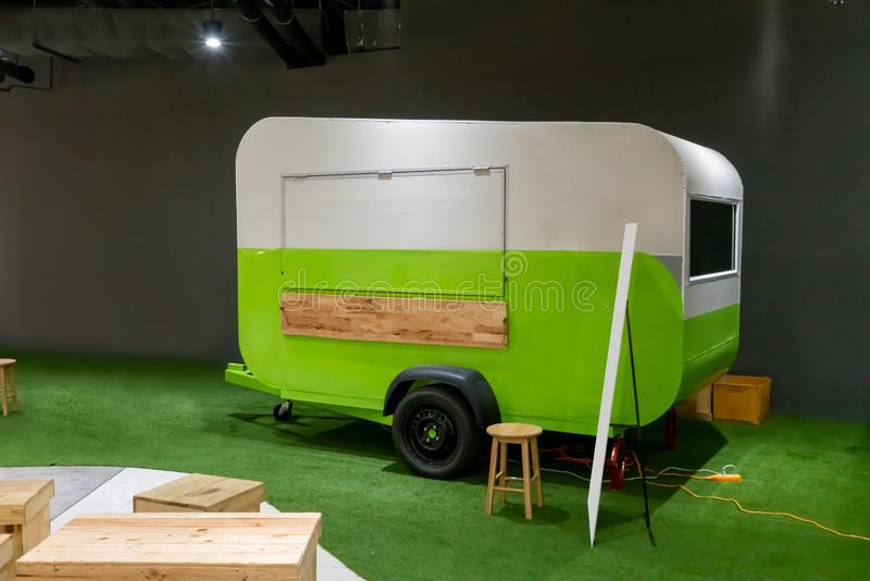 White and green trailer food truck on artificial lawn stock image