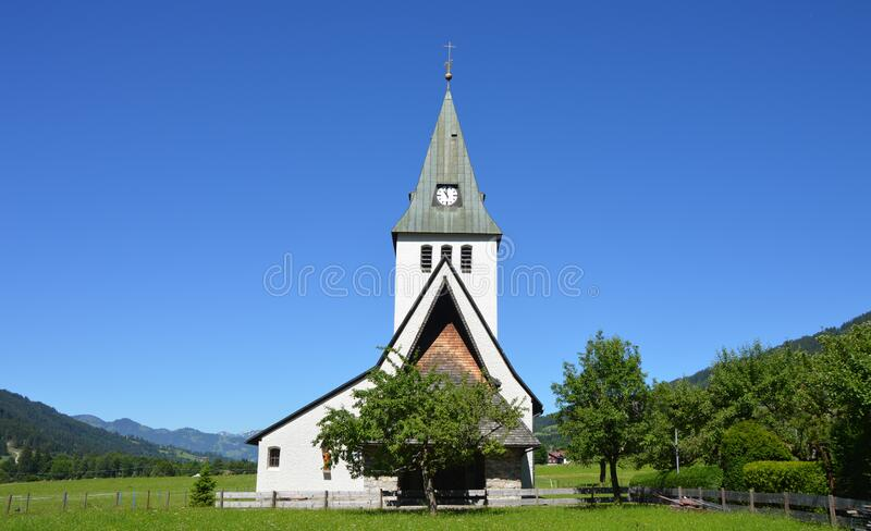 White And Grey Church Near Trees Under Clear Blue Sky During Daylight Free Public Domain Cc0 Image
