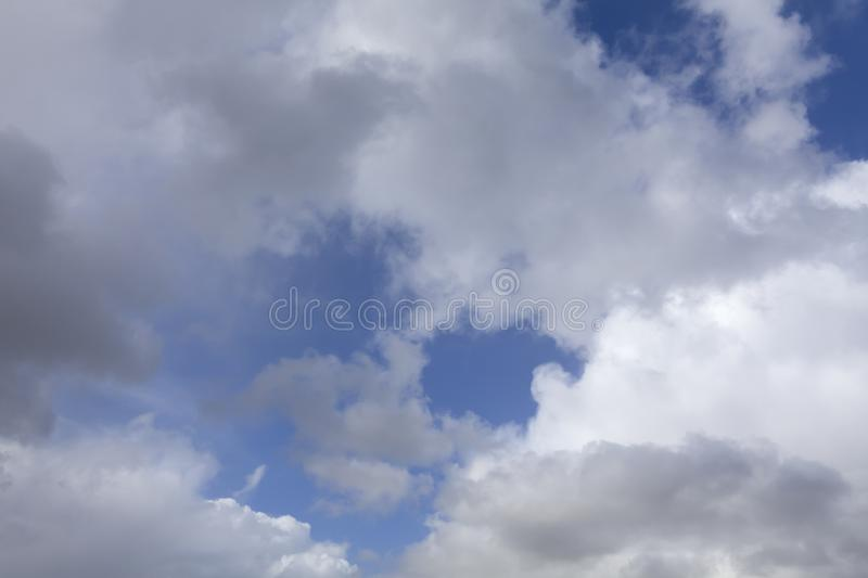 White and grey clouds background. White and grey clouds with blue sky. Nature weather background stock photo