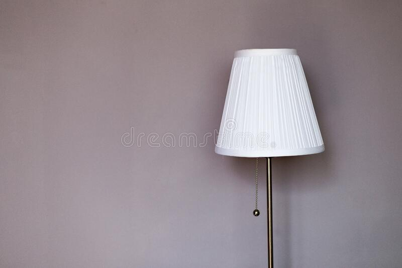White And Grey Metal Pedestal Lamp Nearby Grey Painted Wall Free Public Domain Cc0 Image