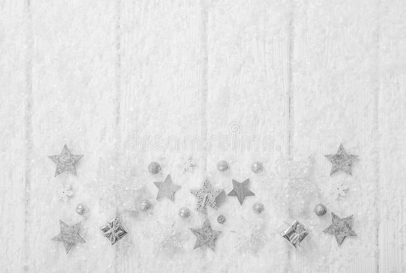 White, grey and silver christmas background with wood, snow and. Stars for decoration in shabby chic stock images