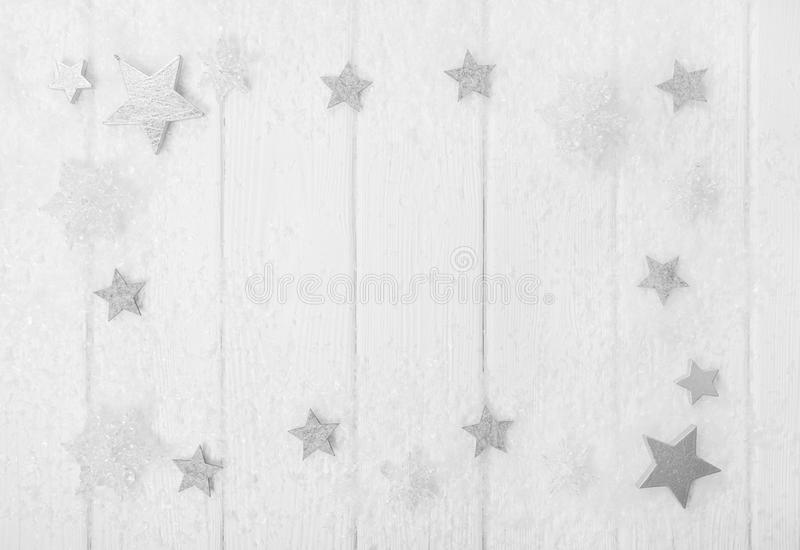 White, grey and silver christmas background with wood, snow and. Stars for decoration in shabby chic stock photo