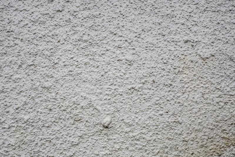 White dirty rough grey stone concrete wall texture royalty free stock photos