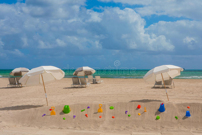 White and grey umbrellas and lounge chairs in the trendy and pop royalty free stock photo