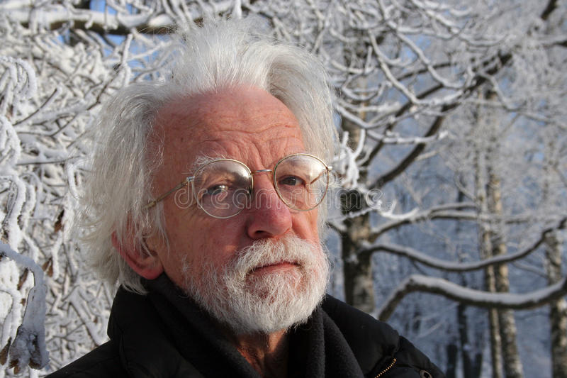 White haired man on winter tree background royalty free stock images