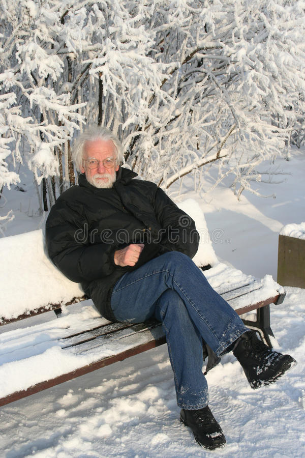 White haired man on winter tree background stock image