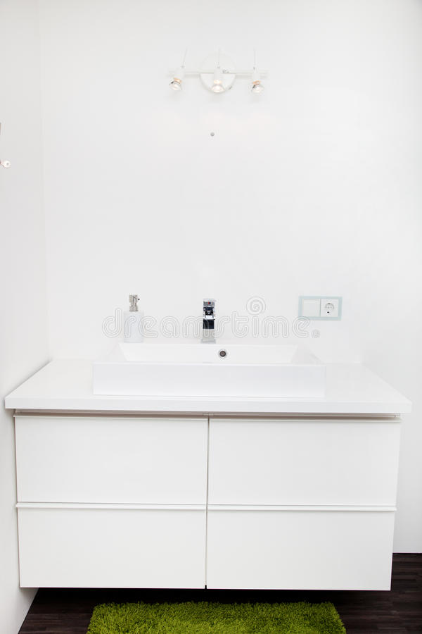 White hand basin unit in a bathroom royalty free stock images